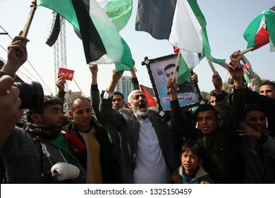 Palestinians angry during protest demanding the departure of Palestinian President Mahmoud Abbas, in Gaza City, on February 24, 2019. Photo by Abed Rahim Khatib