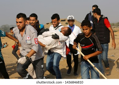 """Palestinians clash with Israeli forces during """"Great March of Return"""" demonstrations at Israel-Gaza border, east of Rafah town in the southern Gaza Strip, on June 28, 2019. Photo by Abed Rahim Khatib"""