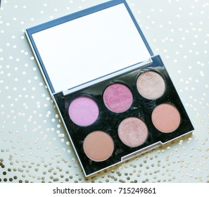 palette of blush and highlighter