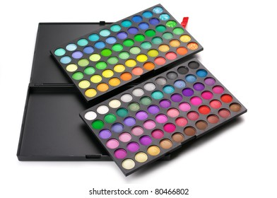 Palette of colorful eye shadows isolated on white background.