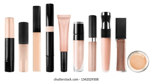 Palette of concealer tubes on white background