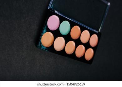 Palette of correctors for the face. Skin cream. concealer for makeup. Professional makeup. Makeup artist tool
