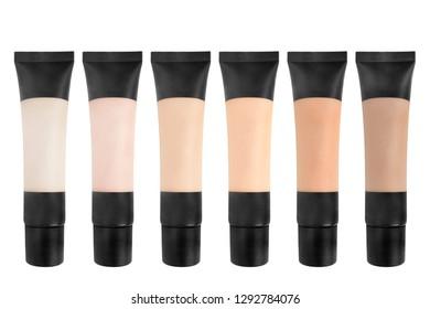 Palette of mat concealer tubes on white background