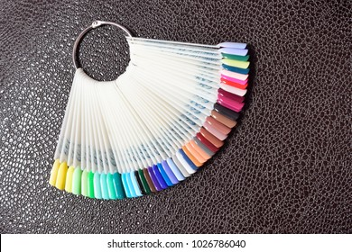 Palette painting nails, in the nail salon. Demonstration on a black background