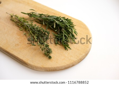 Palette of various spices on wooden palette isolated on white