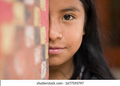 Palhoca, Santa Catarina, Brazil - November 02, 2015: Portrait of young Guarani ethnicity student girl from Morro dos Cavalos Indigenous Community (Yaka Pora)