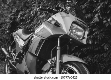 Palic, Serbia: April 26, 2018. Legendary Kawasaki GPZ900R motorcycle from Top Gun movie time, year 1984, photographed outdoor in the park. Nice sunny day.Red-grey color.Double exhaust. Black and white