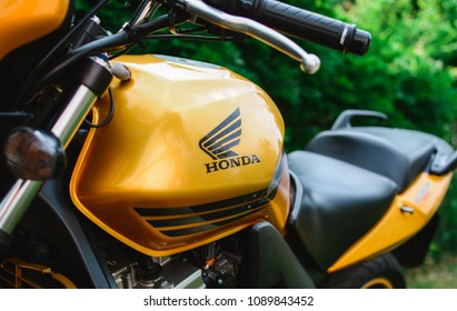 Palic, Serbia: May 13, 2018. Honda CBR 600 japan motorcycle from 2009, photographed outdoor in the park. Nice sunny day. Yellow metallic color. Combination of comfort and sport characteristics.