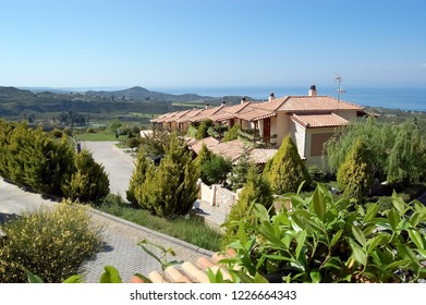 Paliouri, Greece - May 05, 2012: Panoramic views of the scenic mountainous terrain, the blue sea and the villas of the Akritas Ef Zin Villas complex.