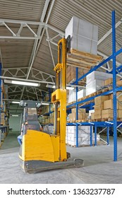 Pallet With Boxes at Forklift Truck Stacker in Distribution Warehouse