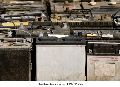 A pallet holds several batteries awaiting recycling at a metal recycling scrap yard