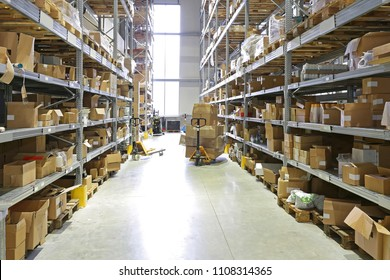 Pallet Jack With Boxes in Fulfillment Warehouse Aisle