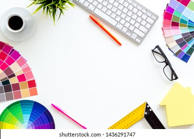 Pallet, keyboard, house figure, coffee and tools for architect work on white desk background top view copyspace frame