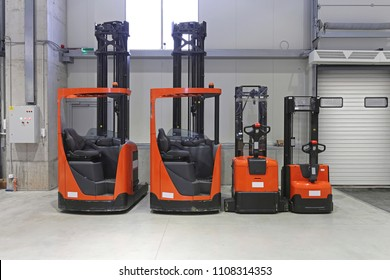 Pallet Trucks and Forklifts in Distribution Warehouse