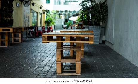 Pallet wood table in an urban alleyway