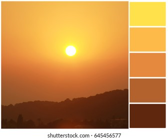 Pallete of colors. Mountains and gold sunset. Harmonious combination of colors. Color mixing.