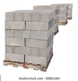 pallets of concrete blocks on a white background