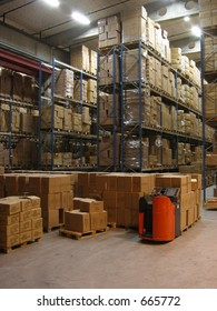 Pallets, shelves and a truck in a warehouse