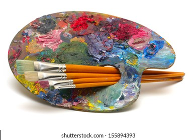 pallette with brushes on a white background
