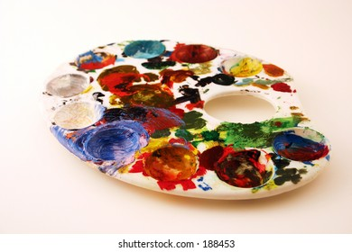 Pallette (metaphor for creativity, innovation, originality) Bright, vibrant colors isolated on white