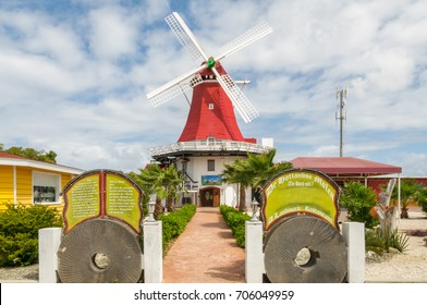 PALM BEACH, ARUBA - DECEMBER 3, 2008: The iconic old dutch windmill at Palm Beach near Oranjestad on the caribbean island Aruba. Palm Beach is the popular high rise hotel area on the island.