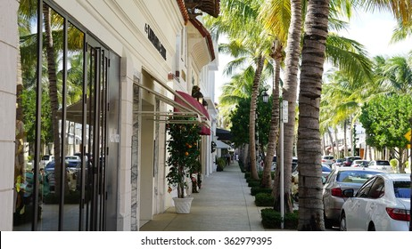 """PALM BEACH, FL - NOV 29: Worth Avenue in Palm Beach, Florida, as seen on Nov 29, 2015. The upscale shopping avenue is voted one of the top three """"Most Iconic"""" streets in America."""