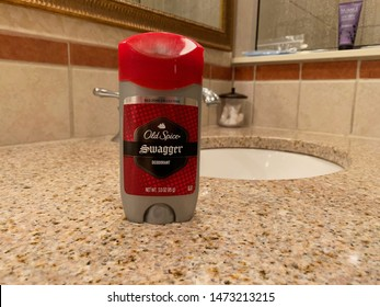 Palm Coast, FL / USA - August 07, 2019: Faucet and sink in an apartment complex with Old Spice swagger deodorant on a marbel countertop.