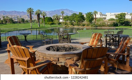 Palm Desert, CA / USA - November 8, 2018: Inviting patio furniture and fire pit overlooking the golf course at the Desert Springs Villas of the JW Marriott Resort