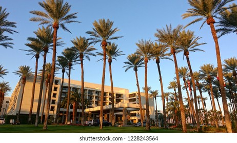 Palm Desert, CA / USA - November 8, 2018: Early morning sunrise at the JW Marriott Resort, exotic palm trees framing the building
