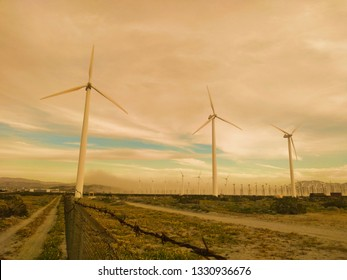 Palm Desert, California - March 4, 2019:  Wind turbines generate green energy in the desert.