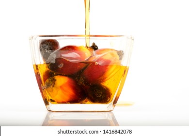 Palm fruits and oil on a white background.