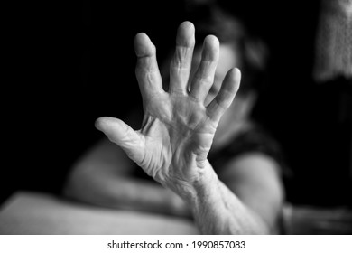 Palm of the hand of an old woman. Black and white photo.