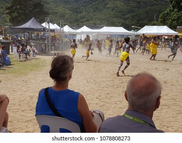 PALM ISLAND, AUSTRALIA - April 22, 2018. Residents of Palm Island, or Bwgcolman (Aboriginal name meaning Many Tribes), & tourists at Cultural Festival of Centenary, celebrating strength & survival.