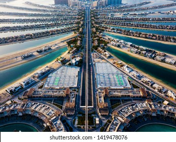 The Palm island with luxury villas and hotels in Dubai aerial view