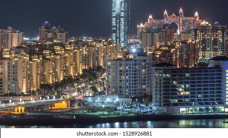 Palm Jumeirah Highway bridge aerial night timelapse. View from Internet city with traffic and illuminated buildings. Dubai, United Arab Emirates