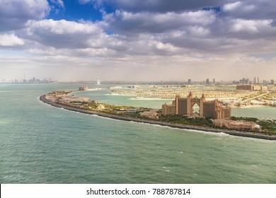 Palm Jumeirah island and Atlantis with Dubai skyline aerial view.