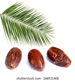 Palm leaf and ripe dates isolated on the white background
