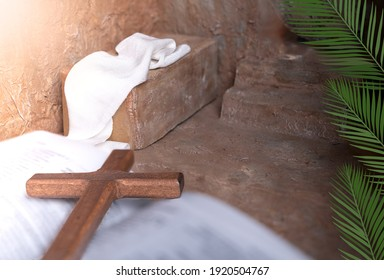 Palm leaves on a empty Tomb and Wooden cross over open bible background with copy space for inscription. Concept of Jesus entering Jerusalem and Christian Easter.