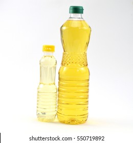 Palm oil and soy bean oil in bottles  and white background.