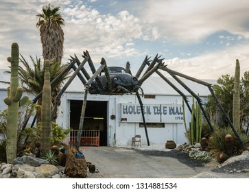 Palm Spring, CA / USA - 10-29-2014:Roadside attraction in the Mojave Desert features a giant black spider welded together with a Volkswagon Bug car at the center.