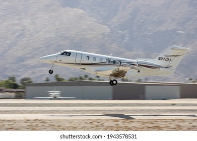 Palm Springs Airport, CA, USA - March 25, 2021: this image shows a Pilatus PC-24 jet with registration N271DL airborne.