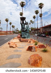 PALM SPRINGS, CALIFORNIA - JULY 18, 2018: Looking east on E. Tahquitz Canyon Way, the sculpture  Agua Caliente Women, by contemporary Native American artist Doug Hyde.