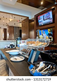 Palm Springs, California, United States - October 26, 2018:  Coffee and Pastie shop inside Renaissance Palm Springs Hotel with two TV playing programming.