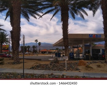 PALM SPRINGS, CALIFORNIA, USA - APRIL 11 : An Exxon Mobil gas station on a busy boulevard.