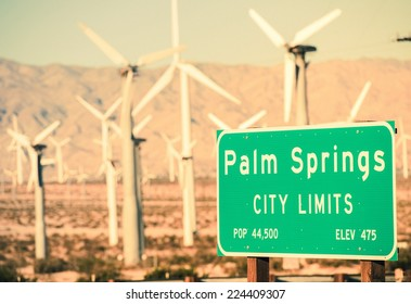 Palm Springs City Limits Highway Sign and Wind Turbines in the Background. Palm Springs, California, USA.