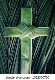 Palm Sunday concept with background of palm cross and palm leaves. With vintage styled background.