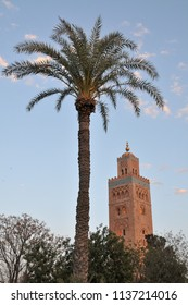 Palm tree and minaret of the Koutoubia mosque in Marrakech, Morocco