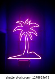 Palm tree neon sign lighting signboard at the entrance to the club(bar).