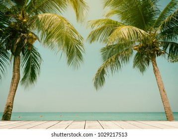 Palm trees coconut wood terrace beach sea sky in the summer of the holiday vintage toned