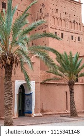 Palm trees and outer part of the Taourirt kasbah in the city of Ouarzazate, in southern Morocco